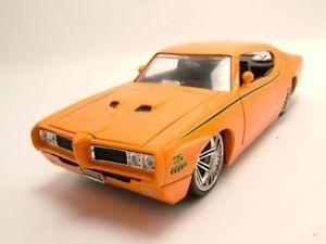 【送料無料】模型車 モデルカー スポーツカー ポンティアックオレンジチューニングモデルカーpontiac gto judge 1969 orange, tuning, modellauto 124 jada toys