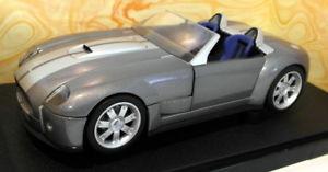 【送料無料】模型車 モデルカー スポーツカー ホットホイールフォードシェルビーコブラhot wheels 118 auto in metallo ford shelby cobra grigio metallizzato art g7220
