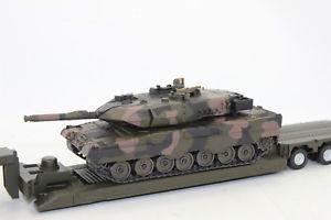 【送料無料】模型車 モデルカー スポーツカー タンクローダトランスポーターsiku 8612 man mit tieflader militrtransporter mit panzer 150 neu in ovp