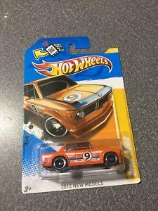 【送料無料】模型車 モデルカー スポーツカー ホットホイールオレンジhot wheels bmw 2002 orange 21