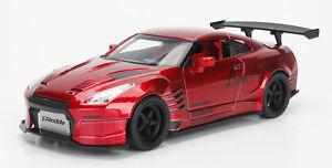 【送料無料】模型車 モデルカー スポーツカー リテールボックスrベンソプラチューナーin a retail box 2009 nissan gtr r35 ben sopra red jdm tuners 124 jada 99215