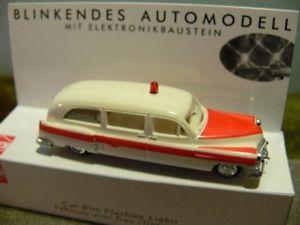 【送料無料】模型車 モデルカー スポーツカー ブッシュキャデラックステーションワゴン187 busch cadillac station wagon ambulance mit blinklicht 5611