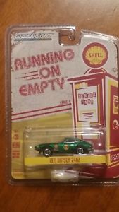 【送料無料】模型車 モデルカー スポーツカー greenlight green machine 1971 datsun 240z chase shell series 4
