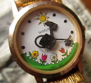 【送料無料】vtg watchit rare gardening theme watering can lady quartz watch needs battery