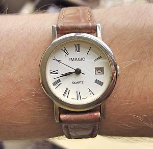 ladies gold plated imagio quartz date watch working