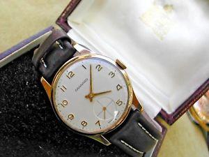 1973 9k solid gold garrard gentlemans wristwatch in original box, serviced
