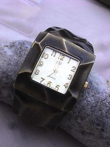 【送料無料】cg montre dame tres stylise ultra plate,bracelet pince bronze vieilli a patine