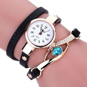 【送料無料】ladies fashion watches eye gemstone luxury watches women gold bracelet watch
