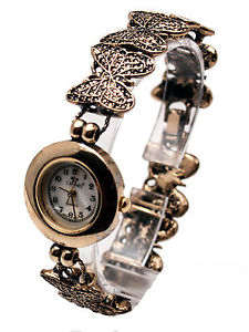【送料無料】cannaswomens goldsilver finish round case butterfly links analog quartz watch