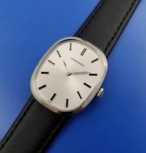 【送料無料】vintage 1960s mans longines *oval case* hand winding fully serviced warranty