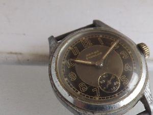【送料無料】a vintage mid size manual wind herma etanche watch