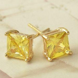 【送料無料】ピアス ゴールドイエローオレンジスタッドstud zirkone farbe amber mit gold gelb laminat 18 kt