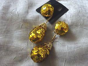 【送料無料】ピアス ピアス ゴールドスパンコールキャッチauffllige ohrclips gold pailetten  neu 9 cm