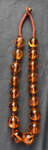 【送料無料】ネックレス クランプオレンジgros collier ethnique grandes perles noues imitant lambre