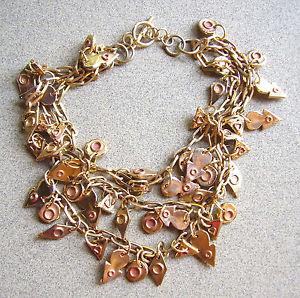 【送料無料】ネックレス メタルドール56 collier a breloques trois rangs metal dore