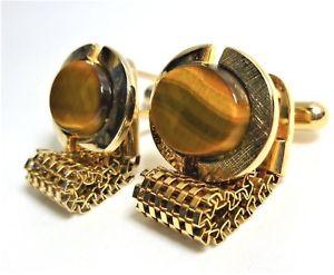 【送料無料】メンズアクセサリ― ビンテージアメリカンゴールドトーンラップアラウンドカフスボタントイレセットvintage american goldtone wrap around cufflinks oval tigers eye set stones wc57
