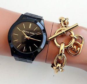 【送料無料】腕時計 ウォッチ ウォッチデルガドトラックカラーoriginal michael kors reloj para mujer reloj mk3221 delgado color de pista negrogoldneu