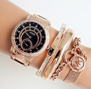 【送料無料】腕時計 ウォッチ アラームステンレススチールゴールデンピンクブラックguess reloj mujer w1006l2 constelacin acero inox rosa dorado negro nuevo