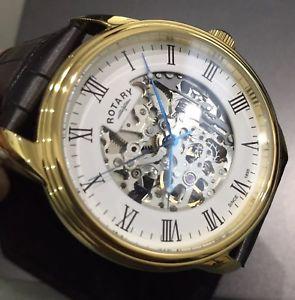 【送料無料】腕時計 ウォッチ ブラックロータリーゴールデンスケルトンアラームホワイトロマーノpara hombres genuino cuero negro automtico rotativo esqueleto dorado reloj blanco romano