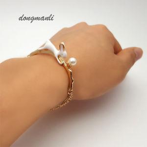 【送料無料】ブレスレット アクセサリ― ブレスレットトレンディsm fr36103 au pays des merveilles lapin charm bracelet boire trendy