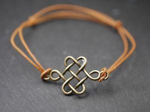 【送料無料】ブレスレット アクセサリ― セルティックノットブレスレットアクセサリーleather bracelet with celtic knotsornamentbronzebrown