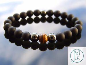 【送料無料】ブレスレット アクセサリ― キャッツアイブレスレットヒーリングelegant yellow tigers eye natural gemstone bracelet 69 elasticated healing