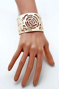 【送料無料】ブレスレット アクセサリ― カフブレスレットゴールドメタルファッションジュエリーアウトカットwomen cuff bracelet gold metal fashion jewelry flowers cut outs floral detail