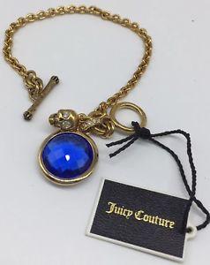 【送料無料】ブレスレット アクセサリ― クチュールブレスレットトグル juicy couture gold tone chain blue gem skull charm bracelet toggle clasp