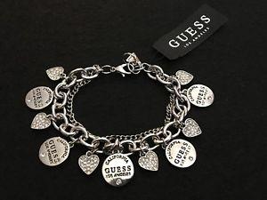 【送料無料】ブレスレット アクセサリ― レディースシルバーラインストーンサークルロゴブレスレットguess womens silver amp; rhinestone circle logo amp; heart charms bracelet