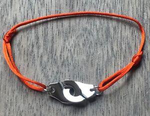 【送料無料】ブレスレット アクセサリ― コードオレンジシルクサテンシルバースチールブレスレットhandcuffs silver steelbracelet on cord orange silk satin