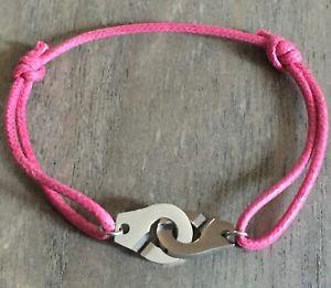【送料無料】ブレスレット アクセサリ― コードピンクボンボンスチールエージェントブレスレットhandcuffs steel agentbracelet on cotton cord pink bonbon