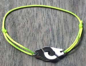 【送料無料】ブレスレット アクセサリ― コードネオンイエローシルバースチールブレスレットhandcuffs silver steelbracelet on cord neon yellow women men kids