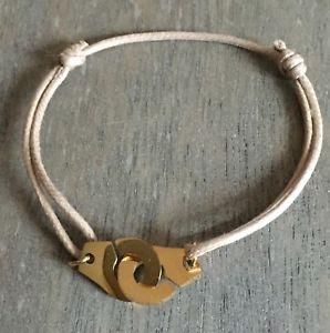 【送料無料】ブレスレット アクセサリ― ベージュコードスチールゴールドモードブレスレットbracelet handcuffs on beige cotton cord adjustable steel gold mode