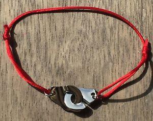 【送料無料】ブレスレット アクセサリ― コードシルクサテンシルバースチールブレスレットhandcuffs silver steelbracelet on cord red silk satin