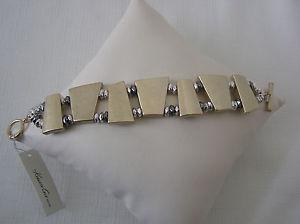【送料無料】ブレスレット アクセサリ― ケネスゴールドトーンワイドストレッチトグルブレスレットkenneth cole gold tone wide stretch toggle bracelet