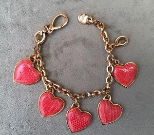 【送料無料】ブレスレット アクセサリ― トッズゴールドレッドレザーハートオーナメントトーンブレスレットtods authentic goldtone charm bracelet featuring red leather heart ornaments