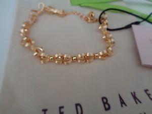 【送料無料】ブレスレット アクセサリ― テッドベーカーリンクゴールドポーチボウブレスレットbn ted baker linked gold bow bracelet with gift pouch