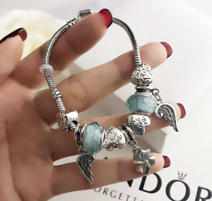 【送料無料】ブレスレット アクセサリ― ステンレススチールペンダントブレスレット womens stainless steel resemble pando wings of angels pendant bracelet