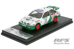 【送料無料】模型車 スポーツカー フォードシエラオリヴェイララリーポルトガル143 ford sierra rs cosworthsantosoliveira rally portugal 1989 trofeu