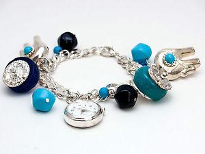 【送料無料】腕時計 インフィニティーシルバーブレスレットアナログウォッチinfinitywomens silver finish elephantstorqois charms bracelet analog watch