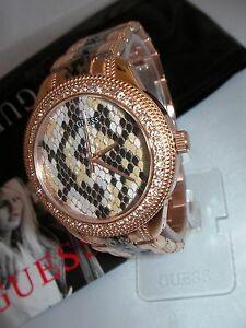 【送料無料】腕時計 レディースサーペンタインローズゴールドウォッチ guess ladies serpentine rose gold python watch w0624l2