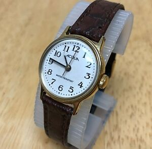 【送料無料】腕時計 ビンテージレディゴールドトーンホワイトレザーvintage acqua by timex lady gold tone white leather handwinding watch hour~runs