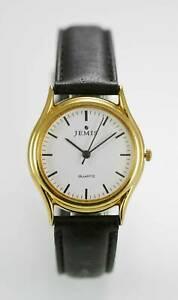 【送料無料】腕時計 メンズブラックレザーステンレスゴールドホワイトクォーツ