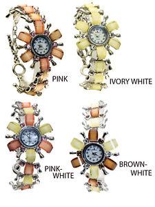 【送料無料】腕時計 シルバーカラーリンクラウンドフラワーケースアナログウォッチamparowomens silver finish metal color links round flower case analog watch