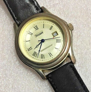 【送料無料】腕時計 ビンテージクオーツvintage stauer date quartz watch works great