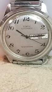 【送料無料】腕時計 ステンレス1970s timex automatic day date wrist watch stainless