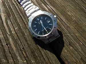 【送料無料】腕時計 ビンテージメンズパルサークオーツvintage mens pulsar quartz water 100 m resist date watch good timekeeper intl