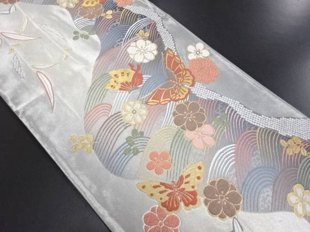 【IDN】 丸万織物製 波に八重梅・蝶模様織り出し袋帯【リサイクル】【中古】【着】