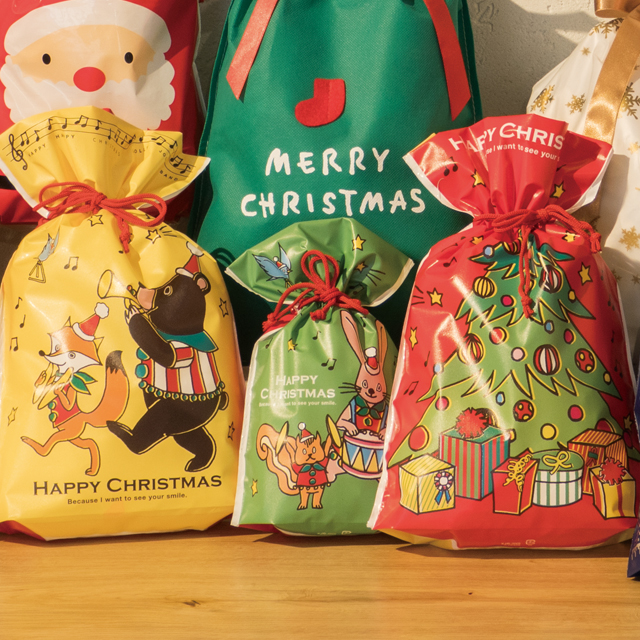 裏表デザインの異なるギフト巾着バッグ。Xmasのプレゼント包装に♪ 1~2枚 少量 少し 枚 クリスマス ジョリーバンド ギフト巾着 巾着 クリスマス ラッピング袋 クリスマス ラッピングバッグ ポリ袋 巾着バッグ ビニールバッグ ビニール袋 クリスマスラッピング ギフト袋 ギフトバッグ プレゼント ギフト ラッピング 袋 おしゃれ かわいい