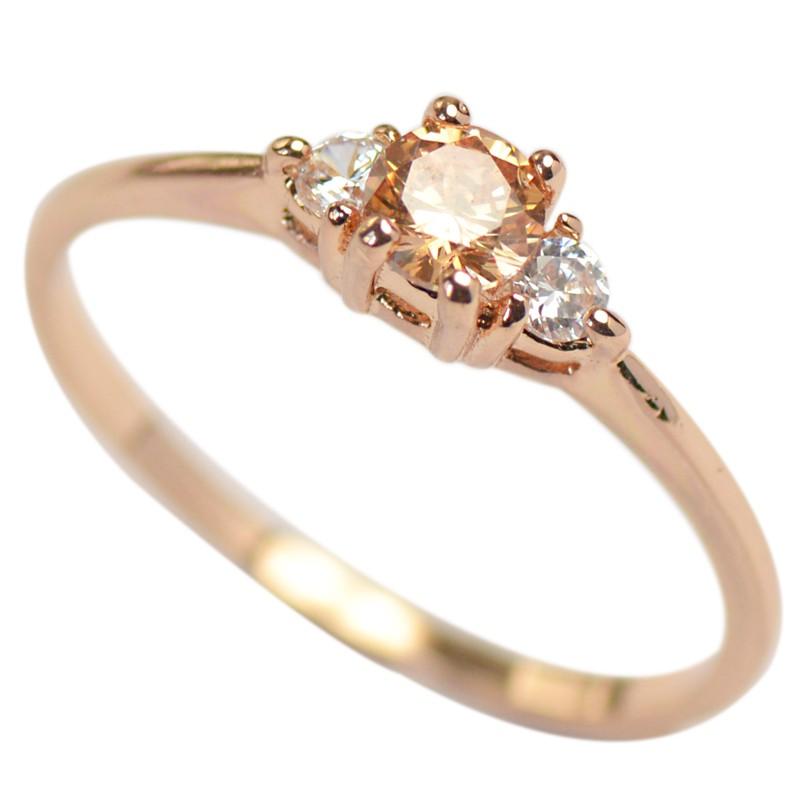 透明感のある美しい光沢が指先をスタイリッシュに リング 指輪 レディース スワロフスキー トパーズ 並行輸入品 K18金RGP ピンクゴールド 誕生石 華奢 金属アレルギー対応 定番